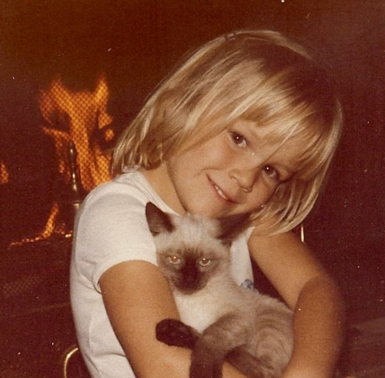 little me fireplace with Clancy.jpg