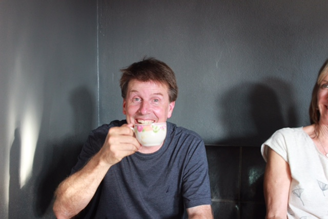 Pastor Jeff demonstrates the Joy of Abonzo coffee.