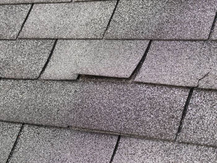 Winter weather can tear shingles off or force moisture underneath them, which damages them further. (Photo: iStock)