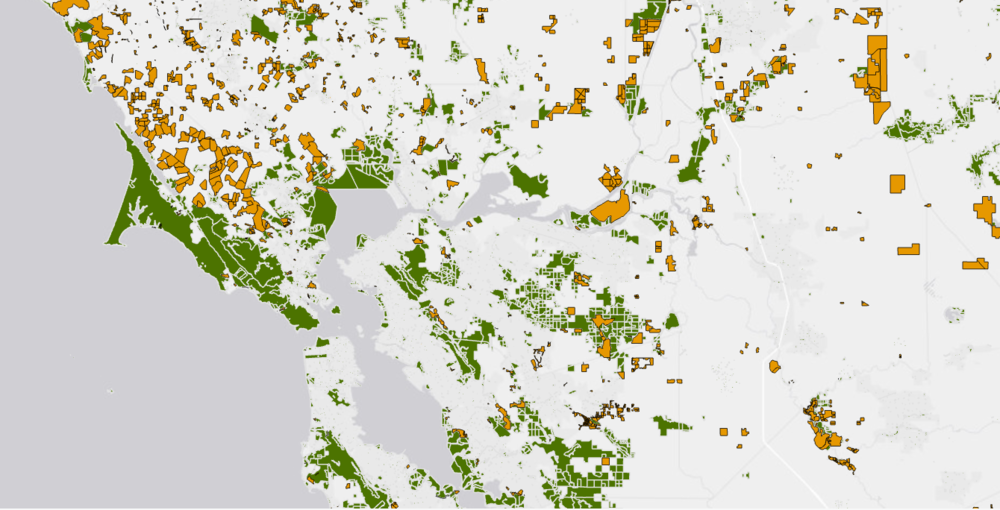Orange blocks represent conservation easements where cattle ranching is allowed but not homebuilding.
