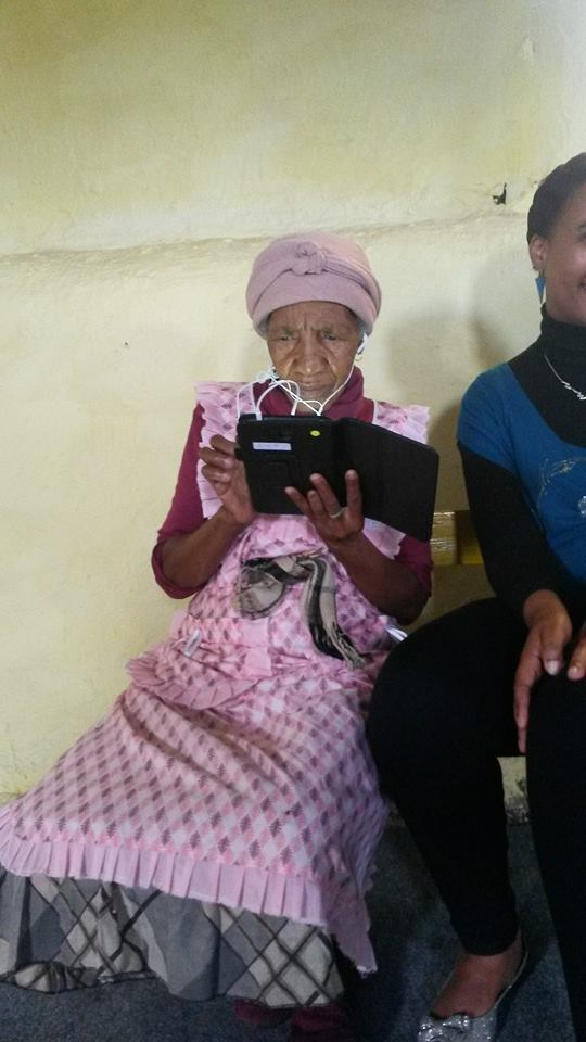An elderly caregiver completing one our baseline questionnaires using a tablet