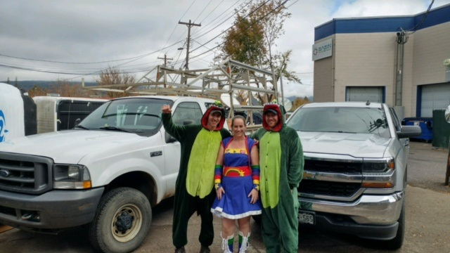 "Monica our ""Rainbow Girl"" Office Manager and Clint Miller ""Chief Dragon"", Manager of our Hearth Department with his trusty sidekick Patrick Kendell ""  ""Lieutenant Dragon"" get in the Halloween Spirit.Thanks to everyone who stopped in to get some sweet treats from these great staff members."