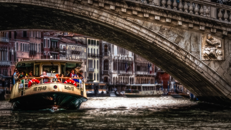 A Venetian Vaporetto or Water Bus as it Passes Under the Rialto Bridge