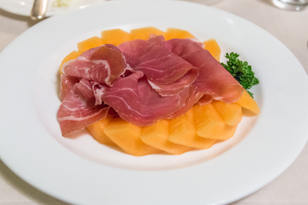 An appetizer of prosciutto and melon