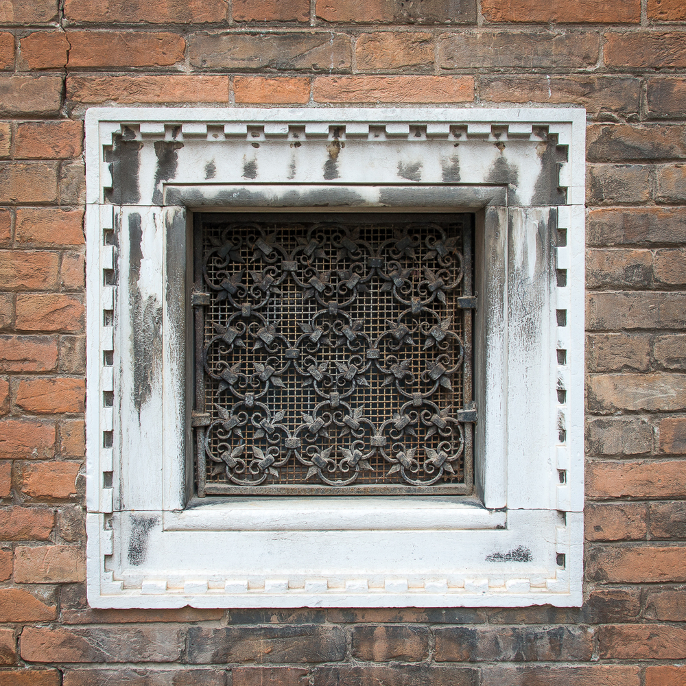 Ironwork framed with carved stone