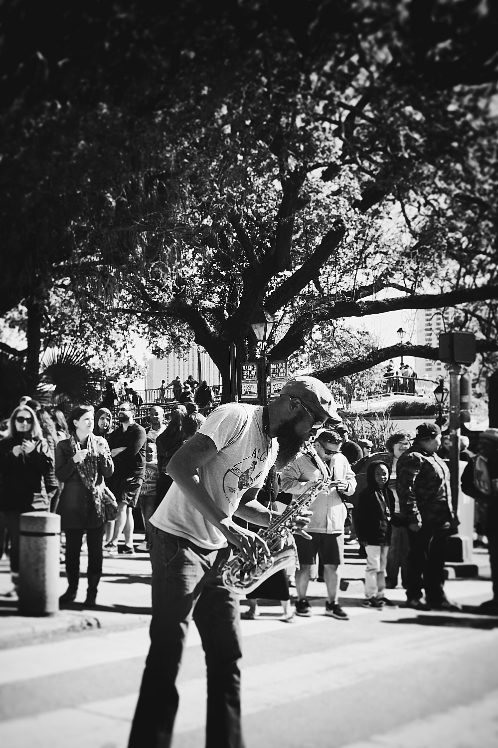 Music is an important part of culture in New Orleans. This musician is playing with his band in front of the Cafe du Monde in French Market.