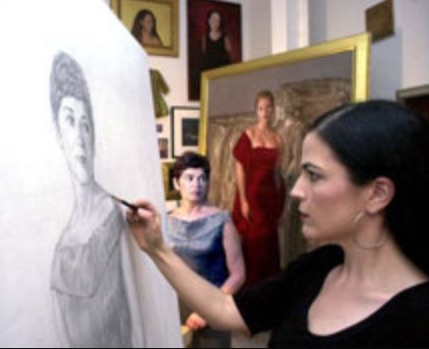 "Leslie Adams at work.. One of her paintings I posed for; ""Athena"" is in the background."