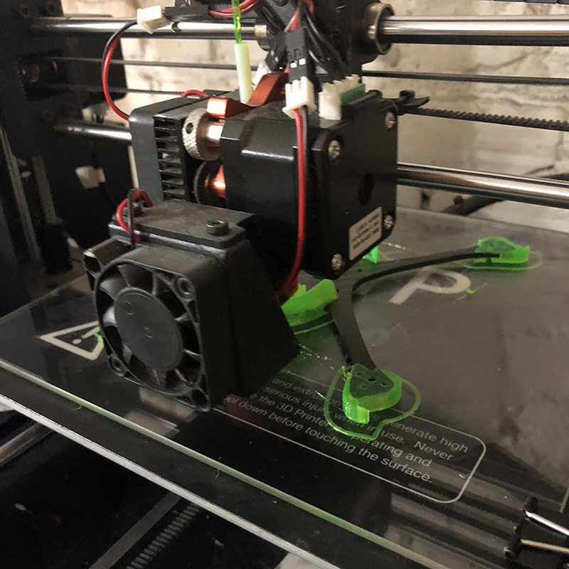 The print gets to a certain height, a script pauses the printer, and the carbon is dropped in and the print resumed.