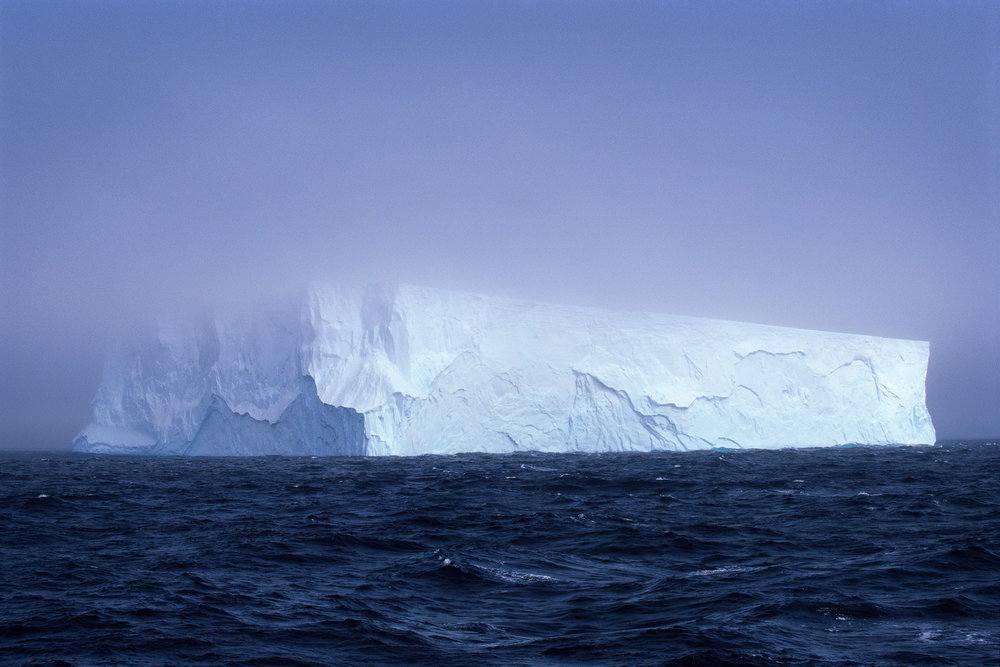 A 1/4 mile wide tabular iceberg, floating north of the South Shetland Islands, Antarctica. | Photographed with a Nikon F5, Nikon 70-200 f/4, Kodak E100 and drum scanned on a Heidelberg Tango