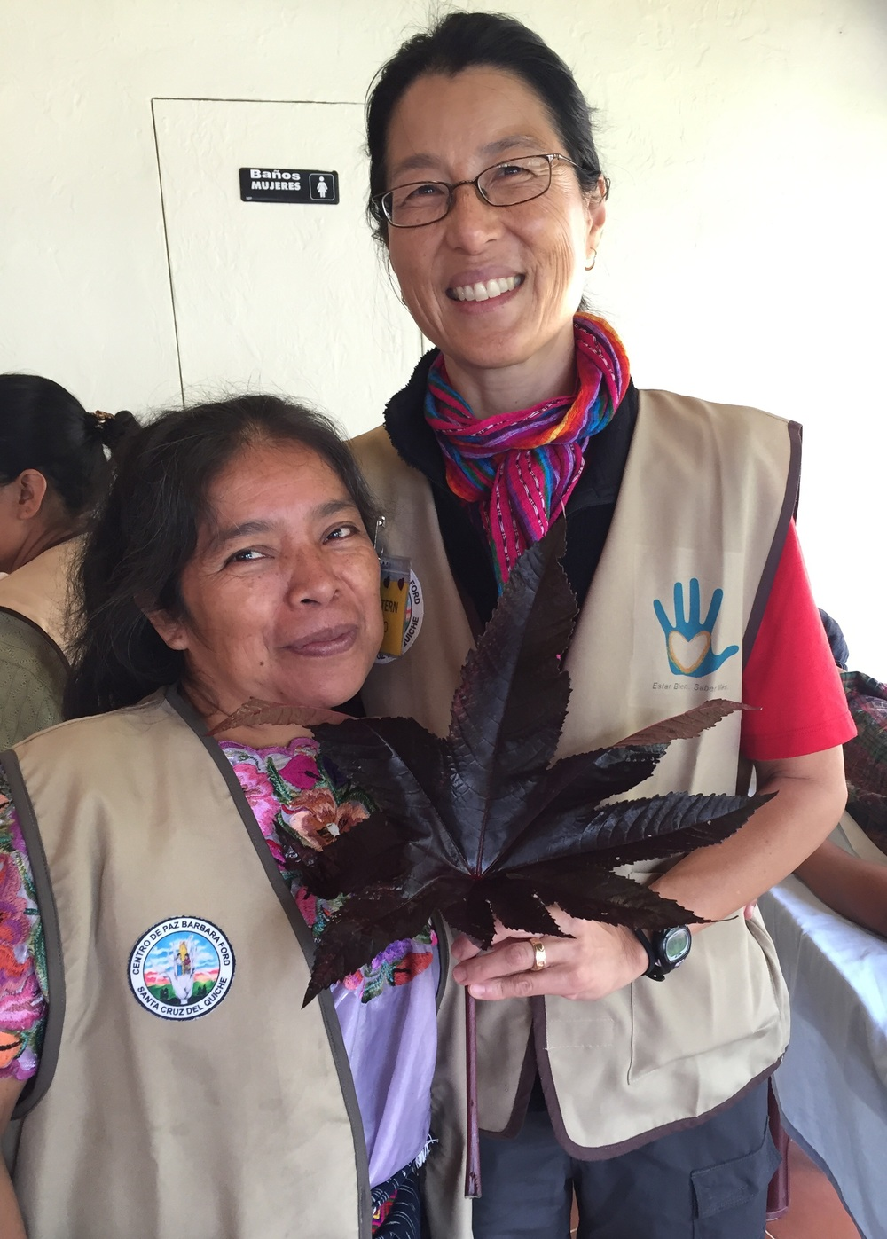 "Sebastiana (left) holding the healing leaf, higuerio, or ""Mano de Christo"". Julie Stern (right) was smart in telling me not to bring any back home 😉"