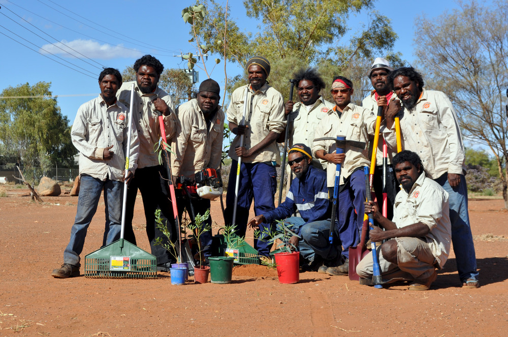 Jigalong rangers tree planting in community with Greening Australia