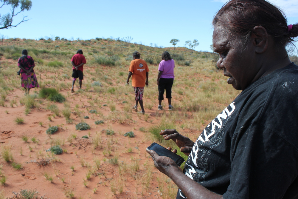 Jigalong rangers using CyberTracker to record fauna monitoring information