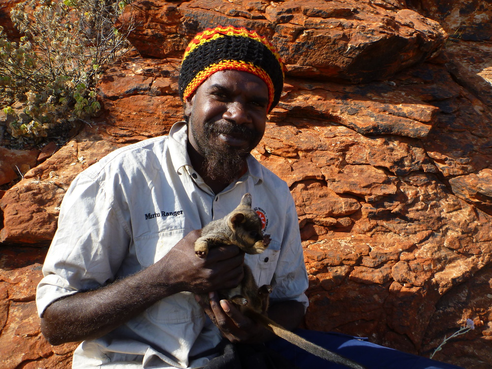 Jigalong ranger, Karlson Jeffires, with a warru