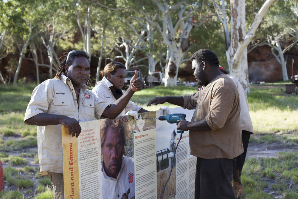 Jigalong rangers installing signage at Pinpi (Durba Springs) campsite on the Canning Stock Route