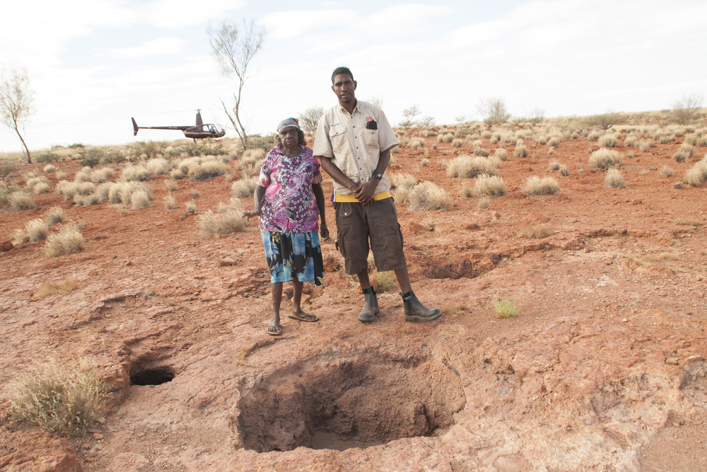 Parnngurr ranger, Clifton Girgirba, with his grandmother on country recording waterhole locations