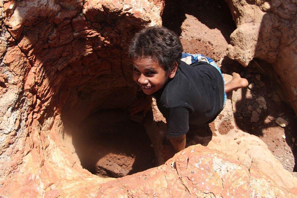 Isaac inspecting Nyakulaji rock hole for water