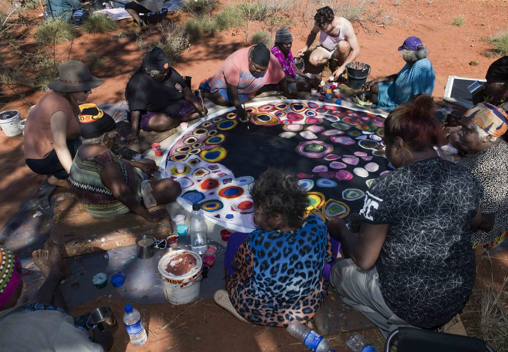 Martu artists working on a collaborative piece