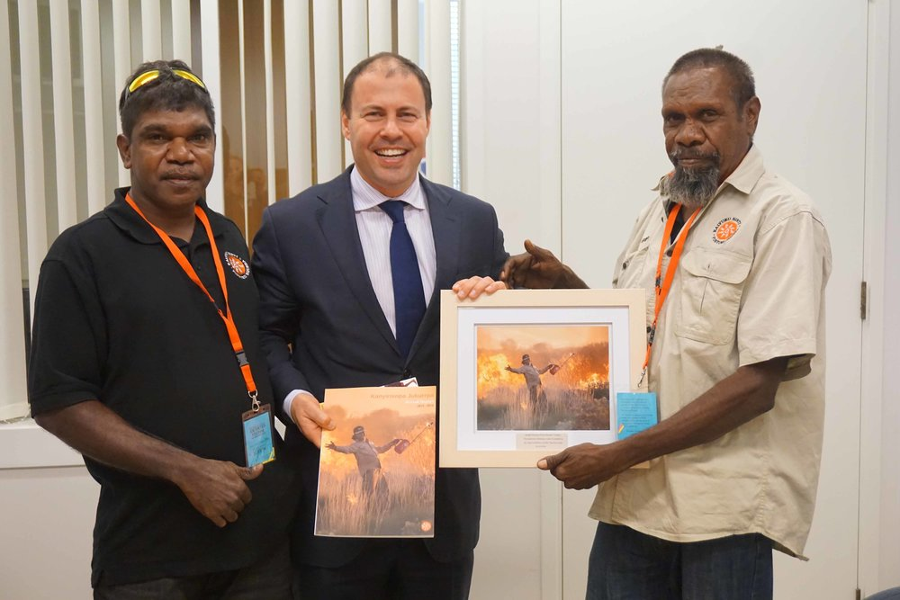 Andrew and Lewis present Josh Frydenberg with a framed photo;