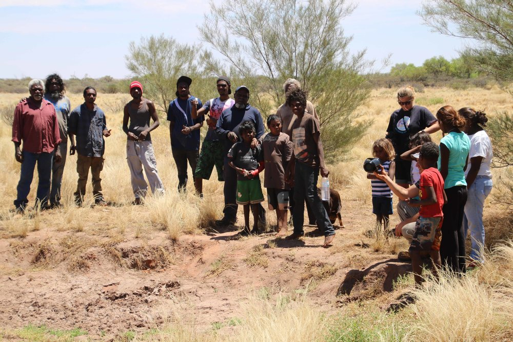 Elders out on country with rangers and school students.
