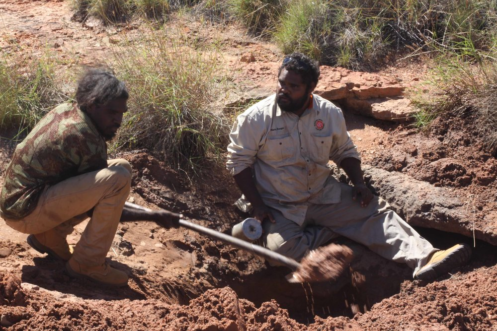 Rangers Brionel Booth and Jeremy Sammy clearing dirt and debris from the Parningkujarra soak