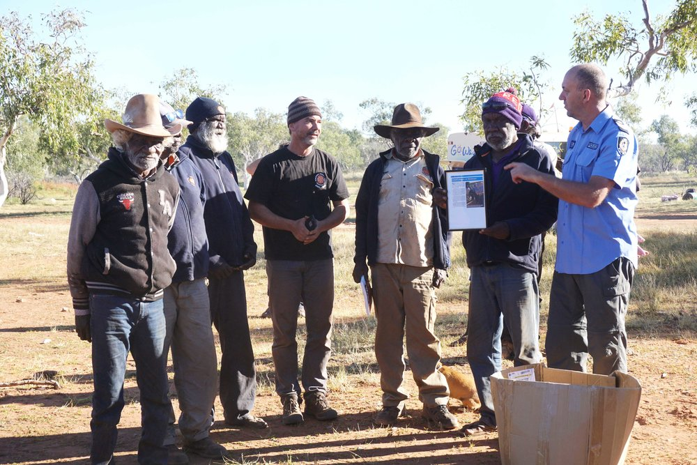 Martu leadership participants talking with Newman Senior Sergeant Mark Flesken
