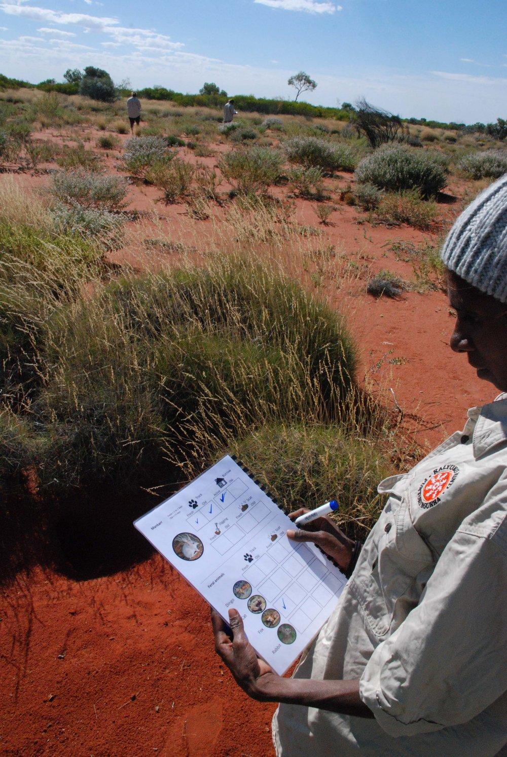 KJ ranger using a field resource that was designed by rangers to record data