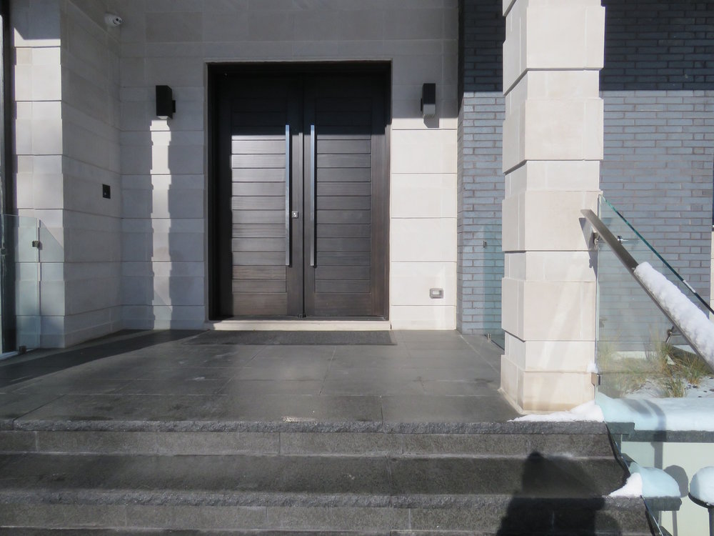 dochia-project-modern-house-thornhill-contemporary-front-door-limestone-glass-railing-stainless.jpg