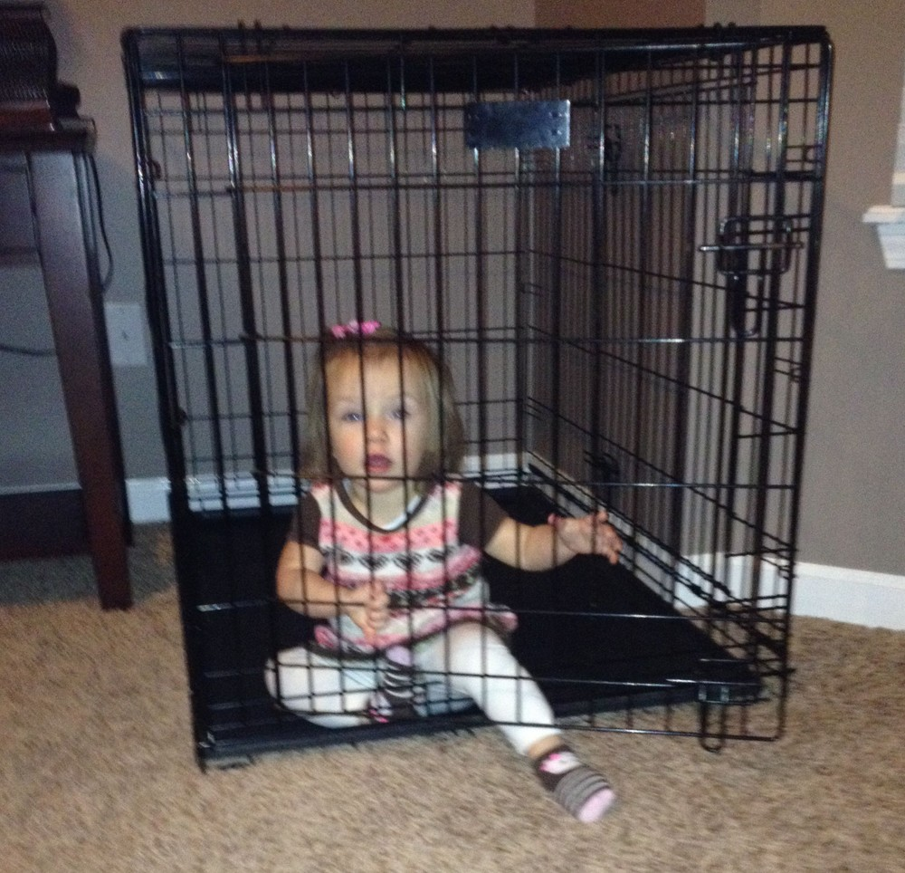 Baby in a dog cage