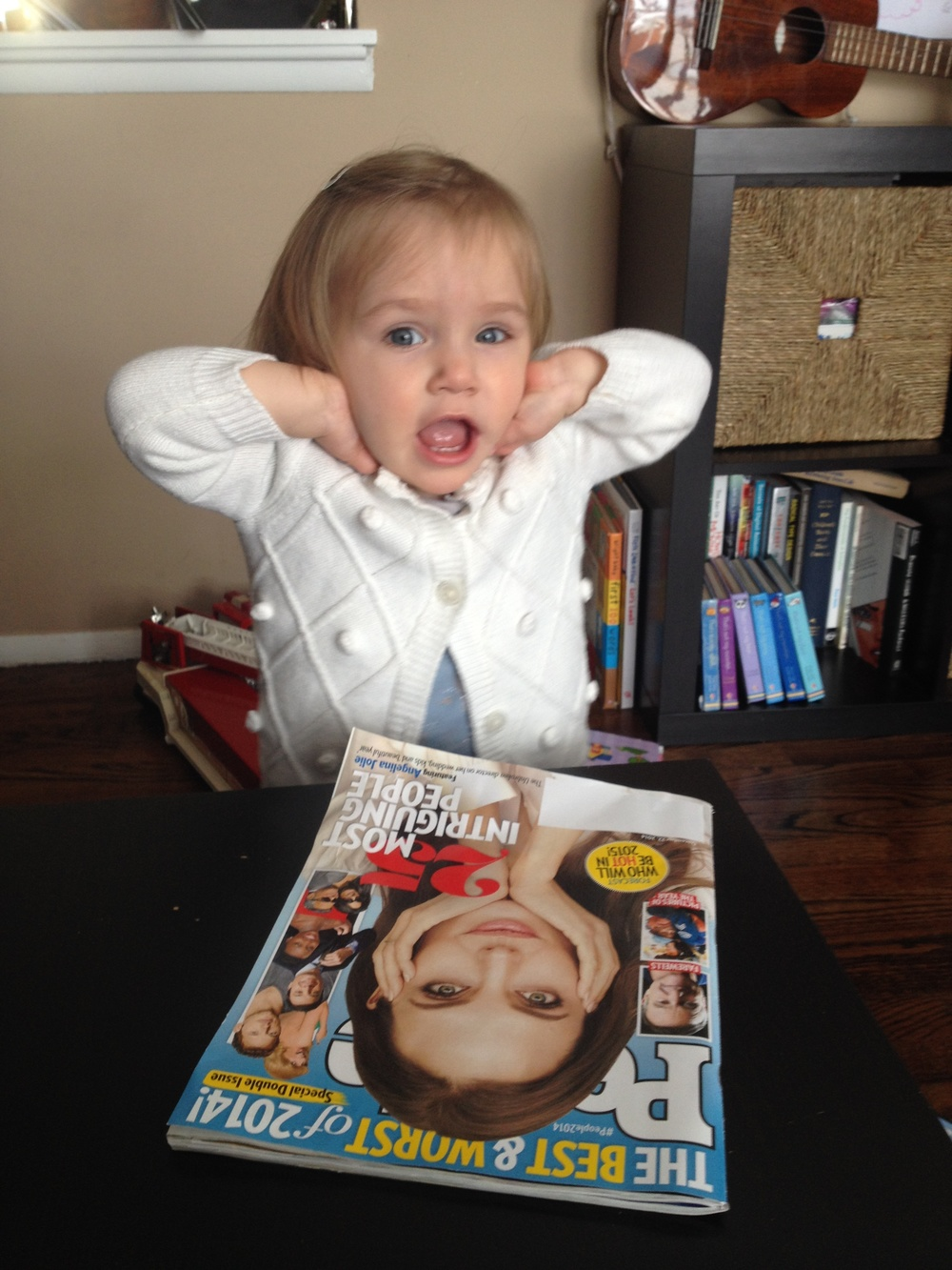 Toddler emulating Angelina Jolie