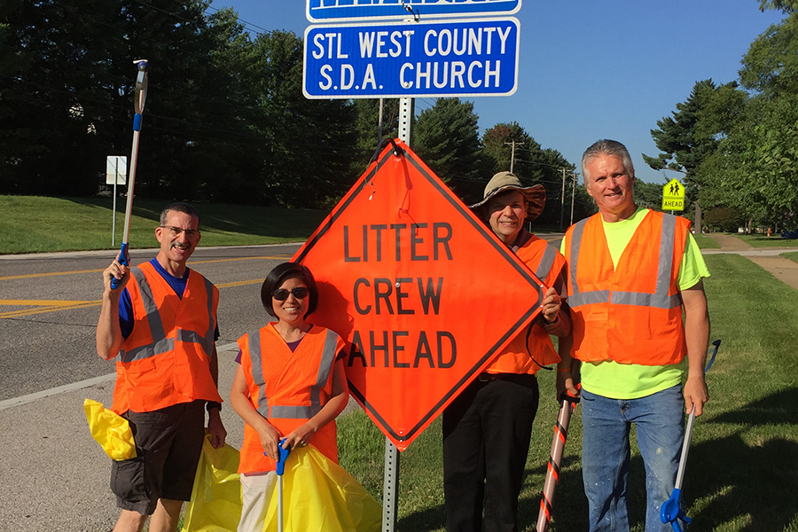 West County Church members Brad Cruse, Yun Hee Cruse, Paul Moore and Brian Clark clean the one-mile stretch of highway in Chesterfield, Missouri. (Photo: Mary Schwantes)