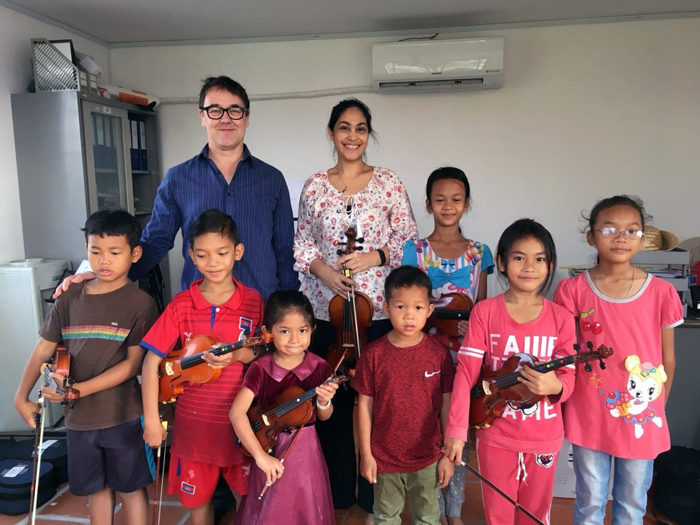 Children from on of the Six Cat Studios-Sunrise Cambodia violin classes