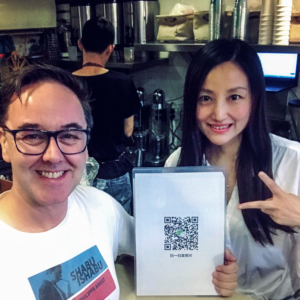 1.Coffee Owner and QR code.jpg