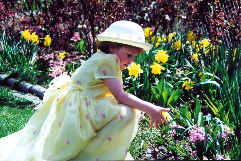 My daughter in her Easter outfit in 2001. We also had a nice garden bed filled with spring flowers.