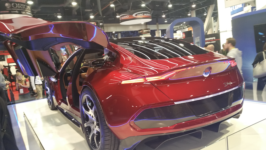 Fisker EMotion concept electric car with both gull wing and scissor doors.