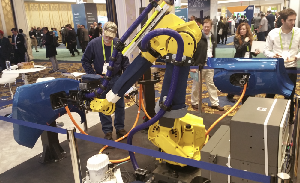 Fanuc industrial robot arm programmed as automated electric car recharging attendant