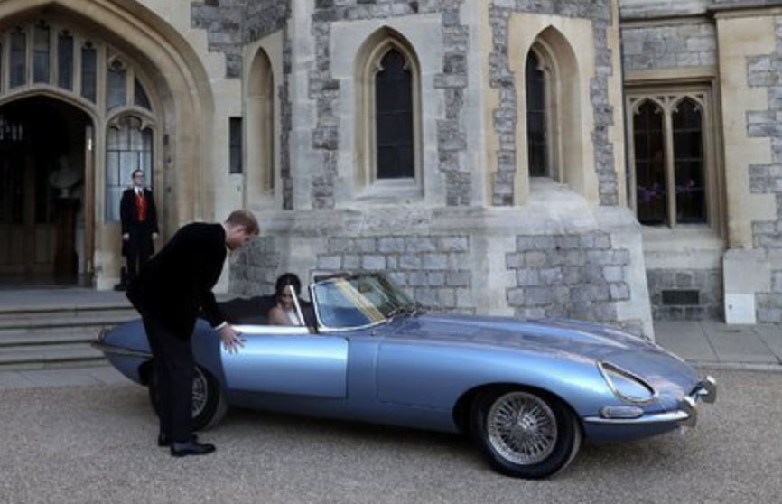 The newly married Duke and Duchess of Sussex left Windsor Castle in a Jaguar Roadster that was modified to be all-electric. Steve Parsons/Press Association, via Associated Press