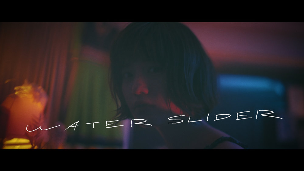 she is summer_waterslider 02.00_00_25_03.Still058.jpg