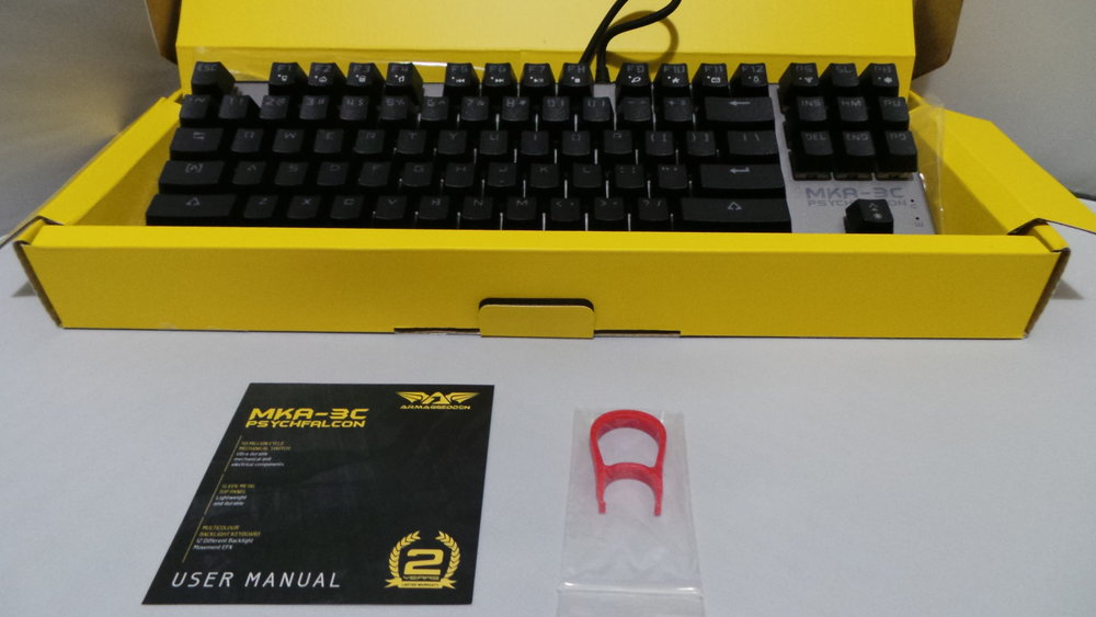 Included in the box is a key pulling tool, and a slip of paper that's a hotkey guide