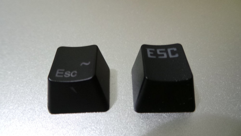 Left: ABS Keycap from Ducky Mini 2.0, Right: PBT Keycap from MKA-3C