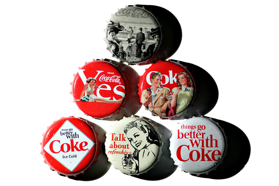 bigstock-Coca-cola-Vintage-Bottle-Caps-28394051.jpg