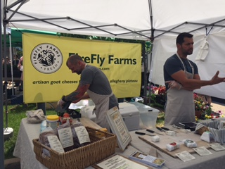 Mike (left) and Pablo (right), owners of FireFly Farms, selling cheese at Dupont Circle.PHOTO CREDIT:Joe Khawly