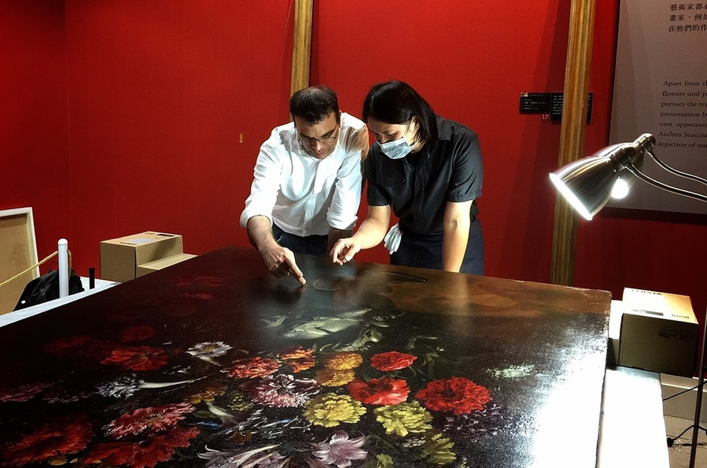 The museum's chief restorer Tsai Shun is reviewing the damage to the painting in Taipei. Photograph: TST Art of Discovery Co. Photo credit: The Guardian website