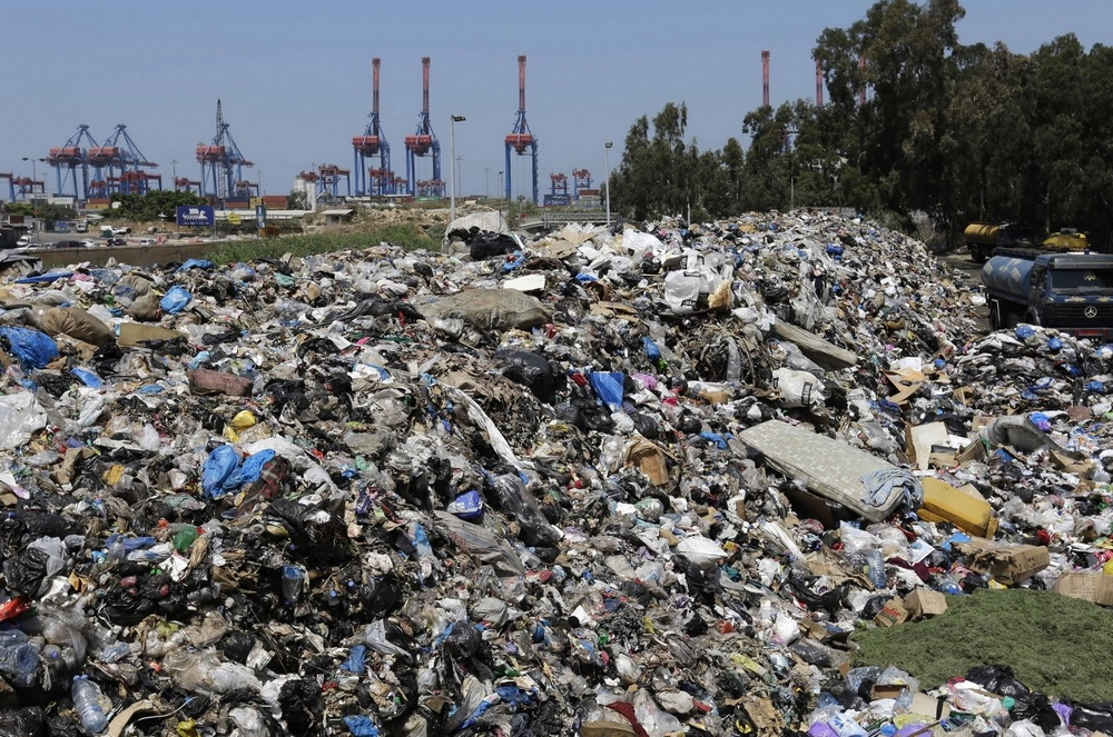 A pile of garbage blocks a street in east Beirut on Aug. 17. Photo credit: Hassan Ammar/AP