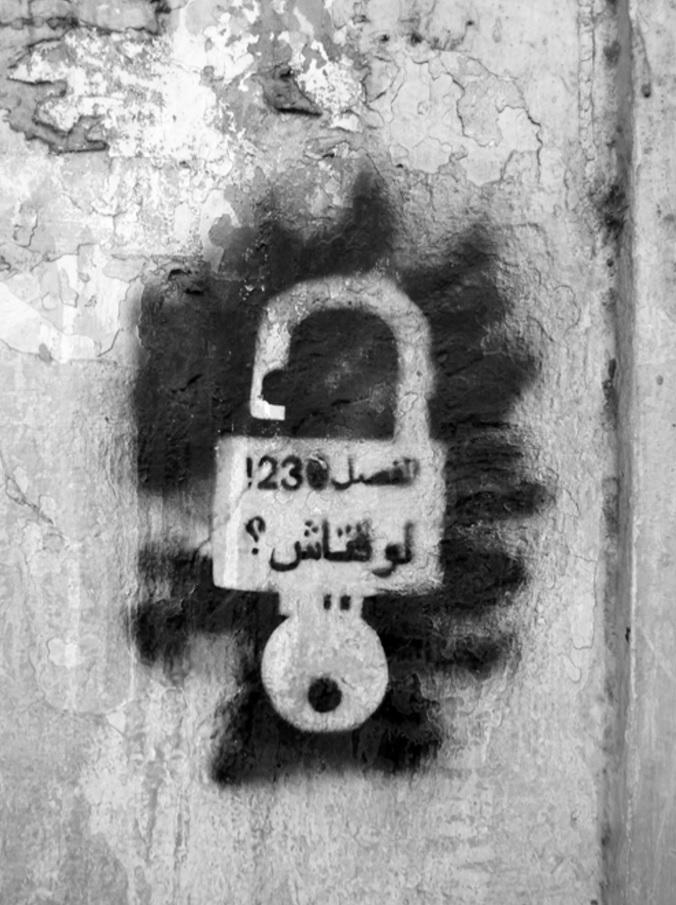 "Graffiti in Tunisian Arabic that says ""Article 230! Until when?"" Photo credit: Inkyfada.com."