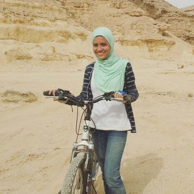 Ahmad next to her bike in Cairo. Photo credit: Noha Elmessiri/GYV