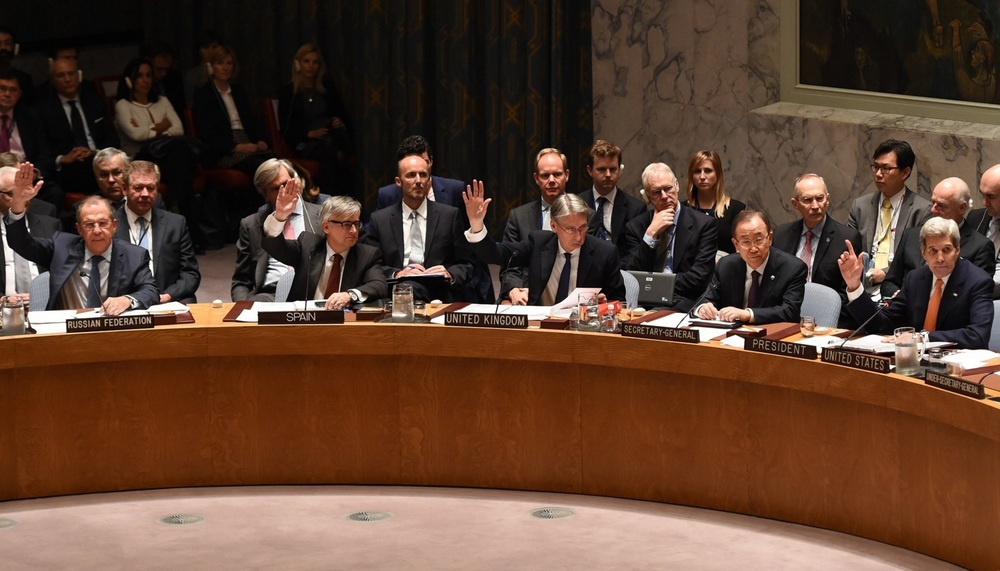 Security Council unanimously voting on Syria's resolution. Photo credit: Timothy A. Clary/AFP