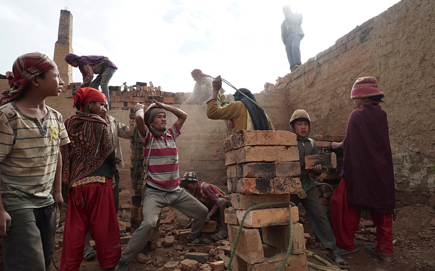 Children and adults work in a brick factory in Panchkhal in Nepal. Credit: The Guardian