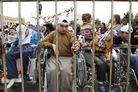 Disabled children and their families protest in Beirut on April 18, 2012. Credit: Reuters/Jamal Saidi