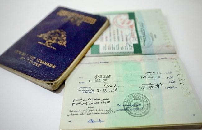 A Lebanese passport renewed by hand.Credit:The Daily Star Lebanon/Grace Kassab