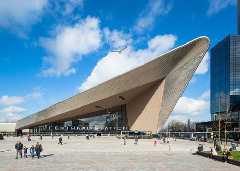 Rotterdam Central Station. Parking for 750 cars and 5200 bicycles is hidden underneath the esplanade. Solar panels partly covering the roof have a high level of transparency to maximize the amount of light entering the station. Credit:  Dezeen.com